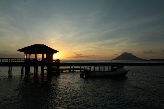 Sunset from our private jetty. Grand Luley Resort