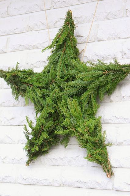 How To Make A Star Wreath - evergreen branches wired to a star form made from limbs.
