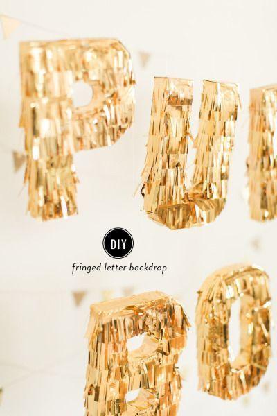 DIY fringed lettering: http://www.stylemepretty.com/living/2015/01/28/diy-fringed-letter-backdrop/ | Photography: Ruth Eileen - http://rutheileenphotography.com/::