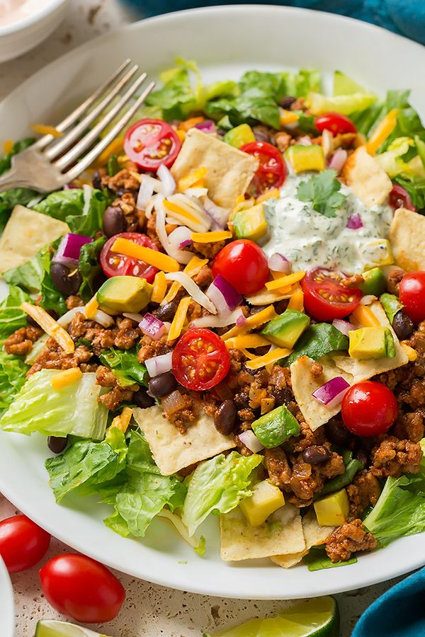 For a low-carb dinner option, try making this ground turkey and black bean taco salad. Filled with your favorite Mexican ingredients and topped with a homemade cilantro lime crema dressing, this summer salad recipe is so good!