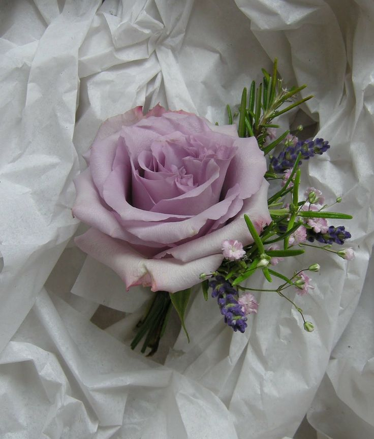 Corsage for mothers of the Bride and Groom.  Maybe with some more lavender and…