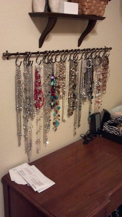 Use a super cheap curtain rod for holding jewelry :)