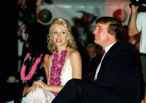 View of from left former model Laura Ann Locklear her daughter Marla Maples and the latter's husband real estate developer Donald Trump as they sit...