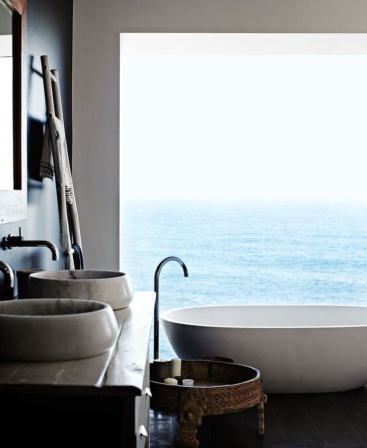 The Apaiser stone bath in the master bedroom ensuite is positioned in the best spot to take in the magnificent ocean view. The bath, along with the basins that were bought as one-offs from Indigo Tile Design, add an organic simplicity to the space. Haughey Group made the timber vanity.  Bath not one off