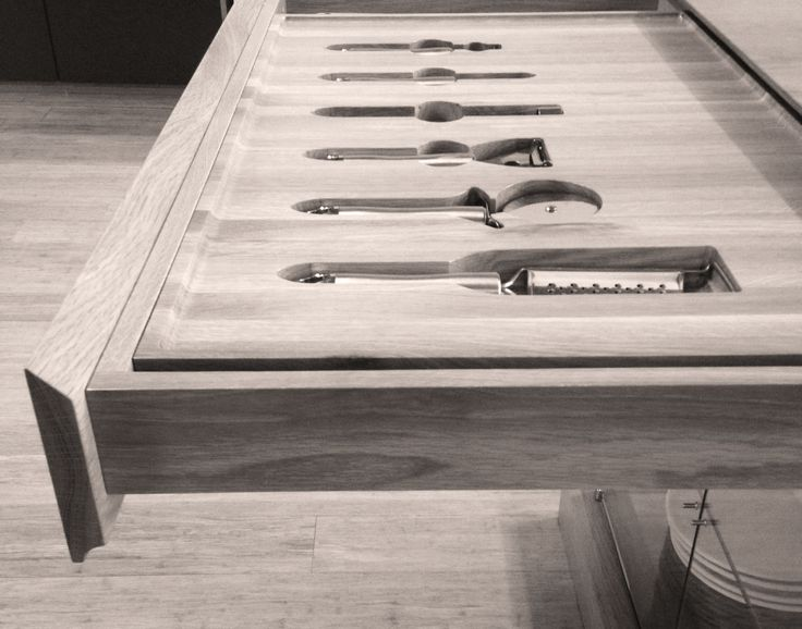 Oak drawer with a reverse finger grip detail which is custom designed to fit our client's kitchen utensils, by ADK Cabinetworks