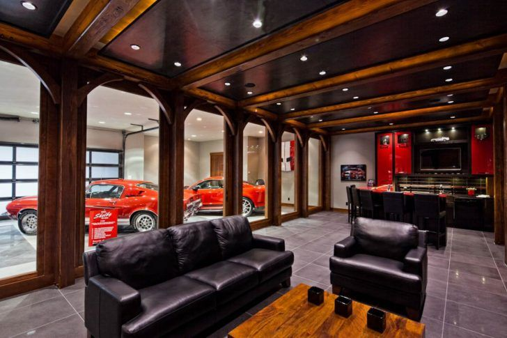 Traditional man cave garage room with glossy red cabinets and crown moulding