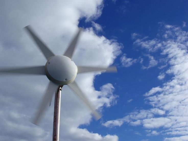 a wind generator rotating on a windy day - free stock photo from www.freeimages.co.uk