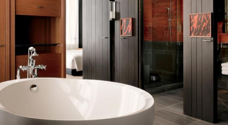 Open space bathroom with large tub.