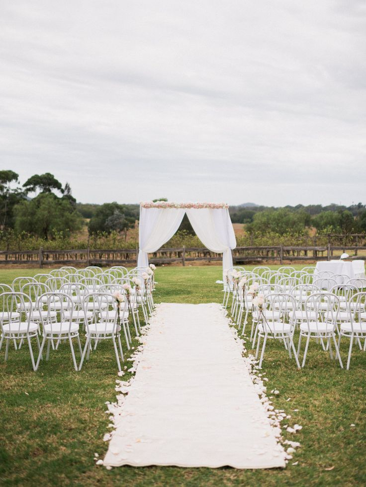 Pretty pastel wedding ceremony arbor set up at Belgenny Farm, Camden.  Photography by We Are Origami Photo