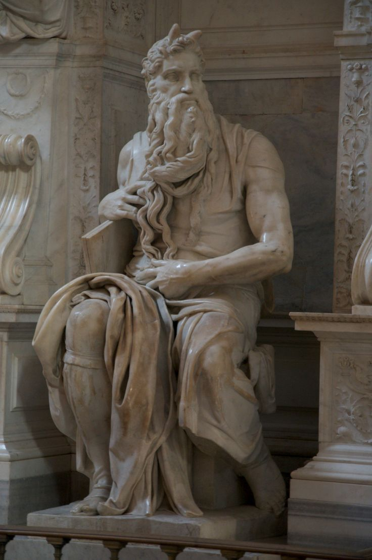 Moses/ Michelangelo. Please note his horns - they were made according to the old translation of the Bible. Moses face radiated - it didn't have horns added after his meeting with God at Mount Sinai.