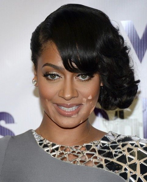 La La Anthony Long Hairstyle: Side Parted Curls