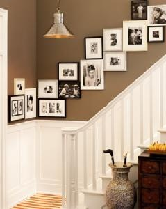 I love everything about this picture. The stairway, the photo layout, the wall colors!! The light!