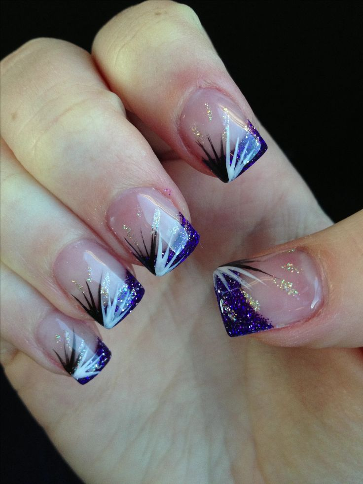 Purple glitter acrylic nails with black & white design.