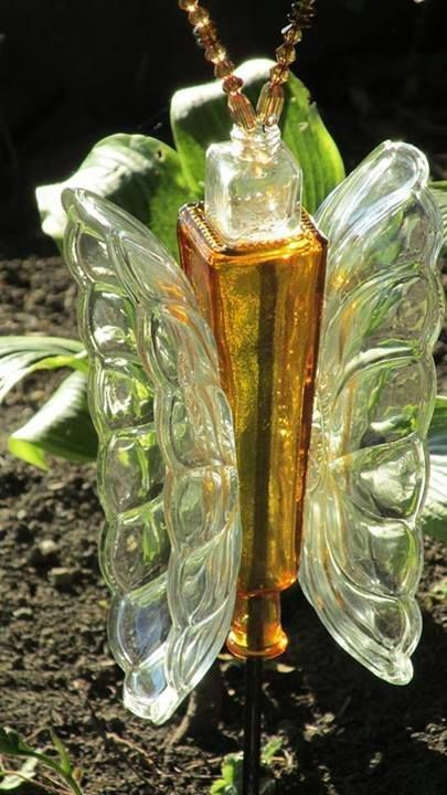 Garden Whimsies  butterfly made with elongated oval dishes and colored glass 4 sided bottle!  Clever!