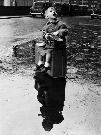 Little Boy Sits on His Suitcase Waiting for a Train to Take Him to the Seaside Valokuvavedos