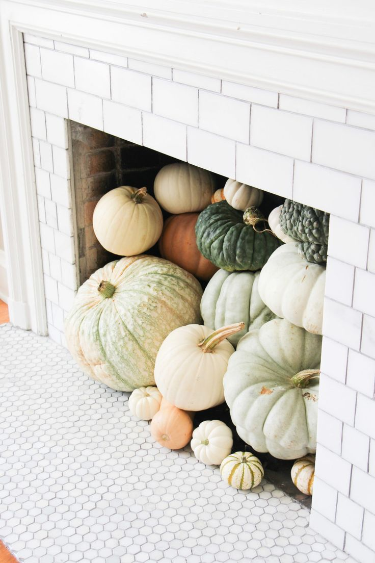 pumpkins in a faux fireplace