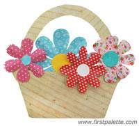 Folding paper flowers in a basket