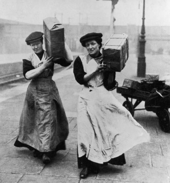 London women employed as porters due to the shortage of men during World War I. Date taken:1915.