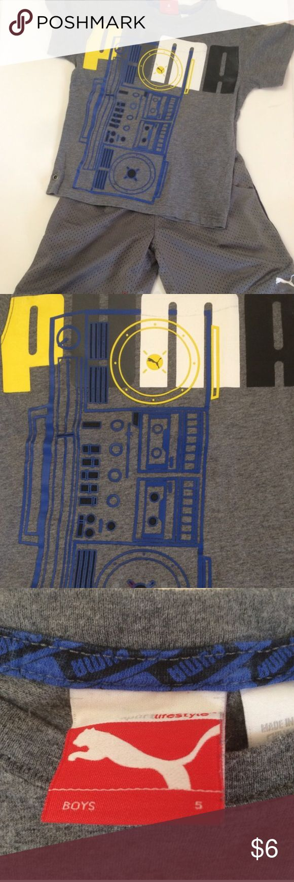 "Puma Tee Grey cotton short sleeve tee with printed ""PUMA"" and boom box on the front. Slight discoloration on the ""M"". I  bought it that way from manufacturer.  Smoke free•pet free Size 5. Puma Shirts & Tops Tees - Short Sleeve"