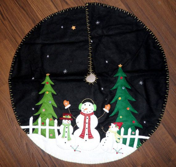 """Beautiful Felt Appliqued snowmen tree skirt  Seed Beads decorate the star ornament  Hand embroidered applique and beaded details 100% Sheep Wool Felt with gold blanket stitching Measures 32"""" Inches"""