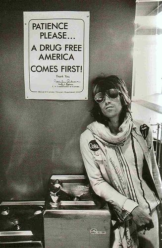 Keith Richards at customs in Seattle, 1972.  This is a photograph of Keith Richards in Seattle airport on the 1972 Stones tour of the USA, the picture is from the excellent book called Dear Mr.Fantasy in which you will find over 300 pic's like this! the work of the brilliant rock photographer Ethan A.Russell.  © Ethan Russell. All rights reserved.