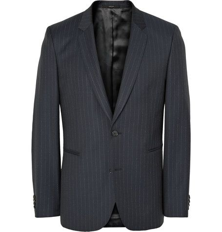 """Known as """"the man who knocked the formality out of the suit"""", Mr Paul Smith creates classic tailoring with unconventional details. Crafted in Italy from navy wool, this slim-fit suit jacket is designed with a pick-stitched pinstriped pattern and a colourful satin lining. Complete the look with the matching trousers."""