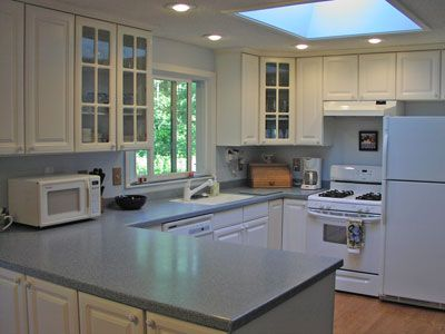 Light Grey Corian Counters With White Cabinets Kitchen