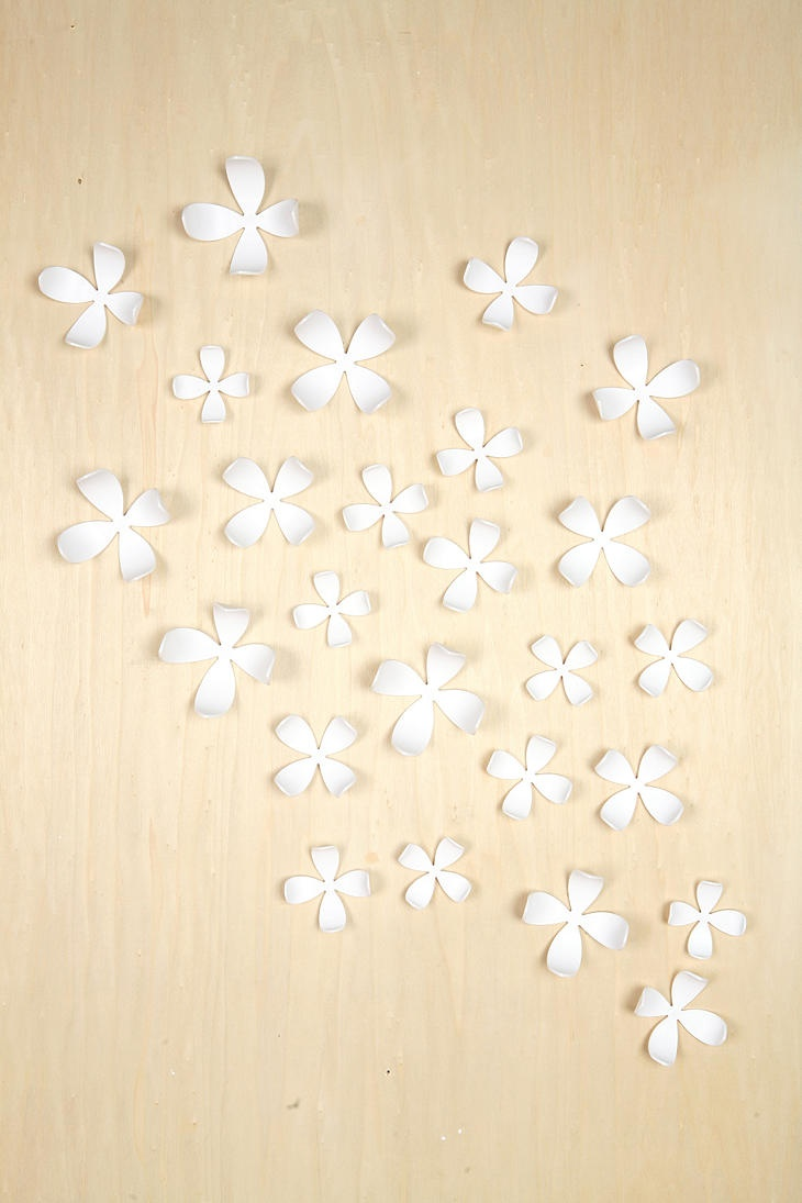 would be even more stunning against a teal or blue wall... Urban Outfitters Set of 25 Wallflower Wall Decor ($40)