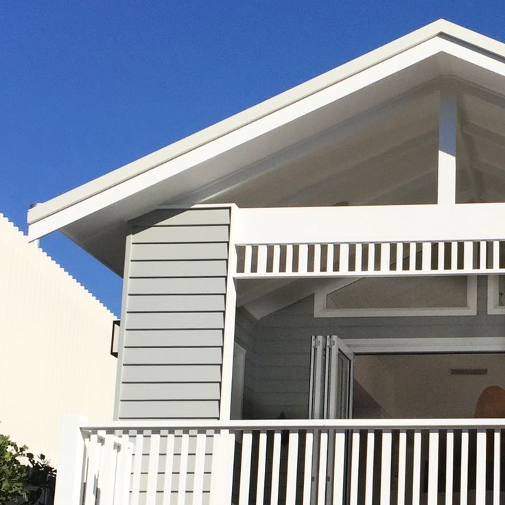 Classic beach house fretwork and verandah posts along with grey and white paint @the_beach_lounge