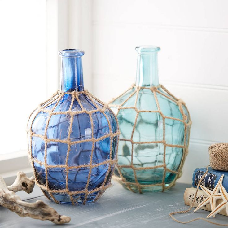 Set of two blue nautical glass bottles with rope details. A perfect Nnutical…