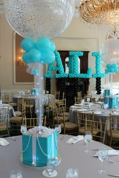 tiffany blue balloon center piece - this would be super easy and inexpensive, you make each table center piece different heights.