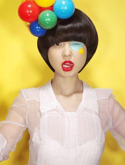 Karen O.'s quirky and colorful style. red lipstick, bob haircut, vidal sassoon style, ball fascinator