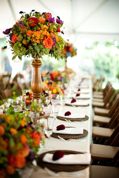 Love this king table we designed with orange & purple dahlias, roses, pods, berry, and hydrangea. Photography by Genevieve Leiper.