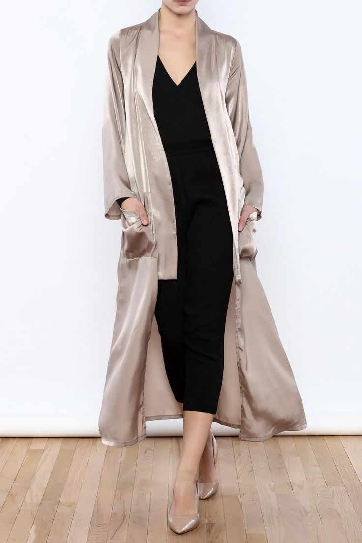 Taupe satin duster with an open front, long sleeves, maxi length, sie pockets and a fold over collar.    Satin Duster by NUDE. Clothing - Jackets, Coats & Blazers - Kimonos & Wraps New York City Manhattan, New York City