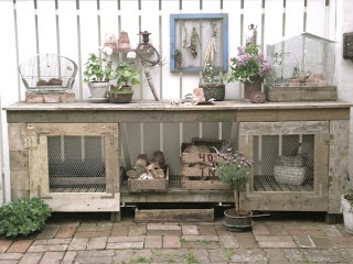 potting bench made with scrap wood or pallets & chicken wire