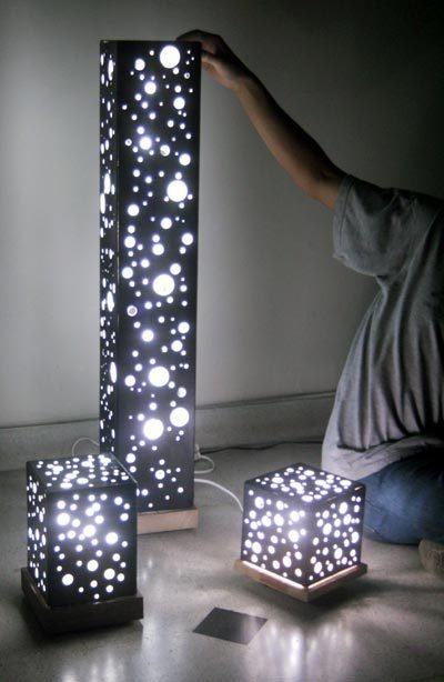 DIY cheese lamps! Inexpensive lighting for community acupuncture clinic. Christmas lights inside MDF (medium-density fibreboard) or perforated masonite (Home Depot has both). Maybe cover openings with muslin or handmade paper to diffuse light.