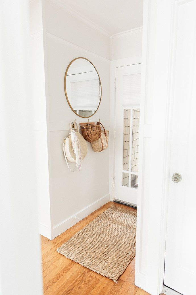 Brass round wall mirror | Entryway | White | Neutral | Airy | Simple