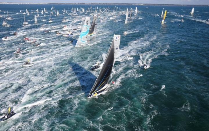 """French skipper Sebastien Josse on his class Imoca monohull """"Edmond de Rothschild"""" (foreground) sails moments after the the start of the Vendee Globe around-the-world solo sailing race off the coast of Les Sables-d'Olonne, western France,"""