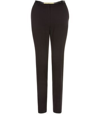 "These black tailored trousers are a staple work-wear piece - try with a white blouse and pointed ankle strap heels to complete.- Slim fit- Belted waist- Hook and zip fly fastening- Pleated front- Slim leg- Model is 5'8""/176cm and wears UK 10/EU 38/US 6"