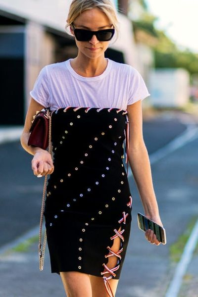 Layer a white t-shirt under a strapless party dress for a fun day-friendly look that will turn heads