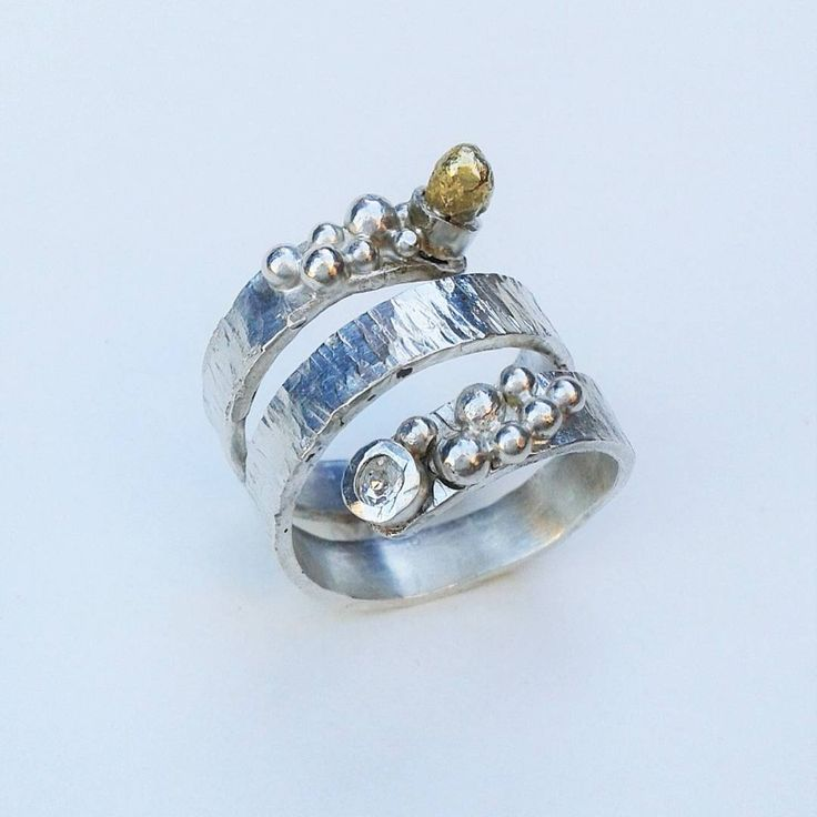 "Sterling silver ring set with silver ""pebble "" swarovski and brass element (from water casting)"