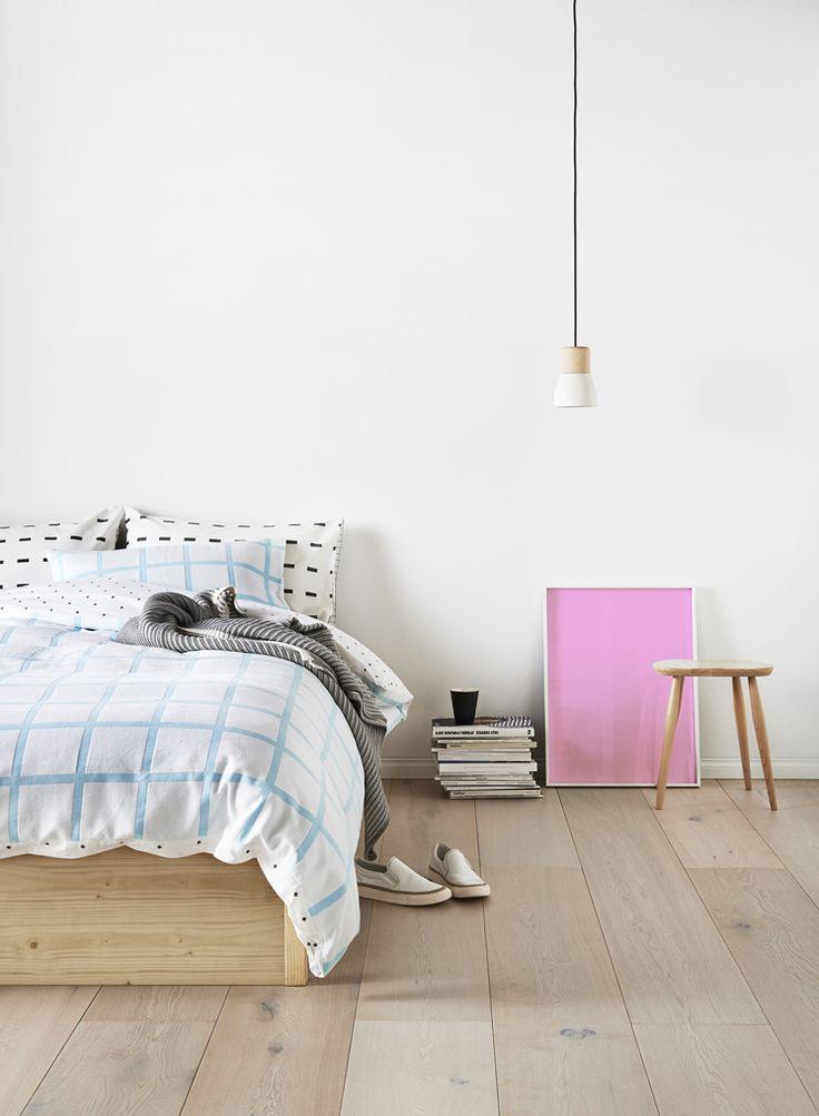 Bedroom // stool / wooden floors / white / simple lamp