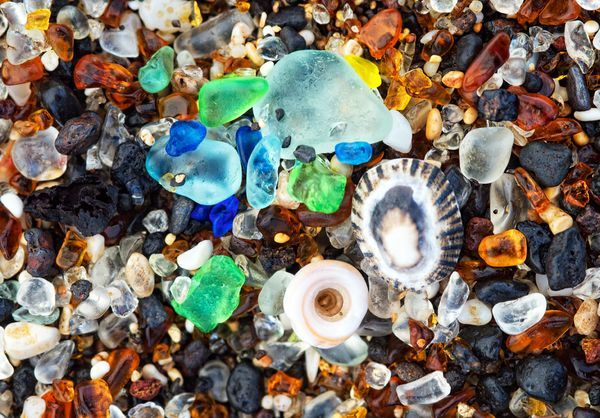 On the island of Kauai there is a beach where a now-closed glass factory used to dump excess glass on the beach. Over time the relentless waves eroded the sharp edges of the glass. Now all that is left is little rounded pieces of glass that have become part of the sand.