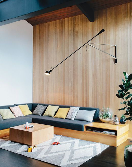The sofa in the family room was designed by Helgerson with Magnifique fabric by Kravet. The 265 Wall Lamp is by Paolo Rizzatto forFlos, and the pine coffee table is from The Good Mod, a local shop in Portland.