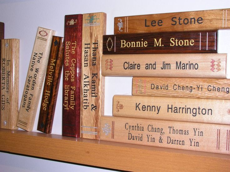 Beautiful Book Spines | Laser Engraved Bookspines Close Up: This is a very cool idea-especially since we are a school of education. We could have the metal plates to look like books-a creative possibilty