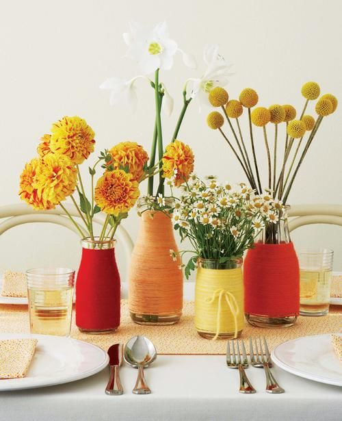 Diy wedding idea colorful upcycled centerpieces glass for Glass bottle centerpiece ideas