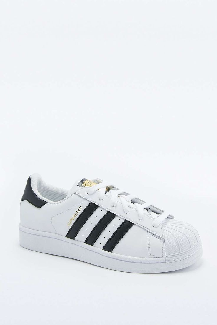 Shop adidas Originals Superstar White and Black Trainers at Urban  Outfitters today. We carry all the latest styles, colours and brands for you  to choose ...
