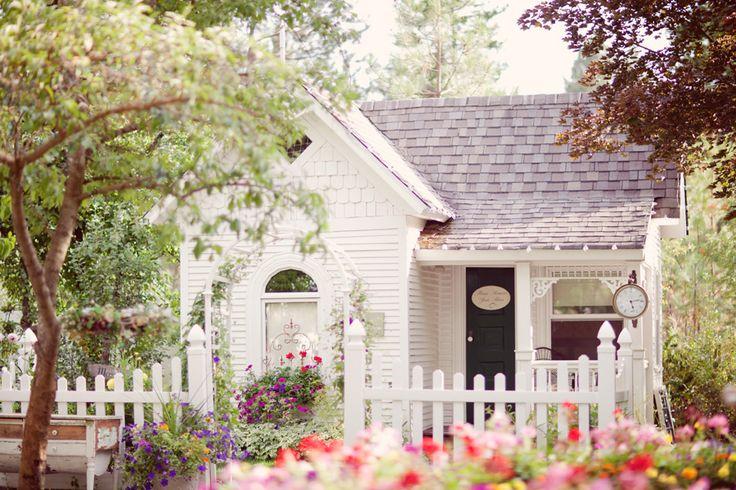 Little white cottage with picket fence via Venue Spotlight: Belle Victorian Gardens