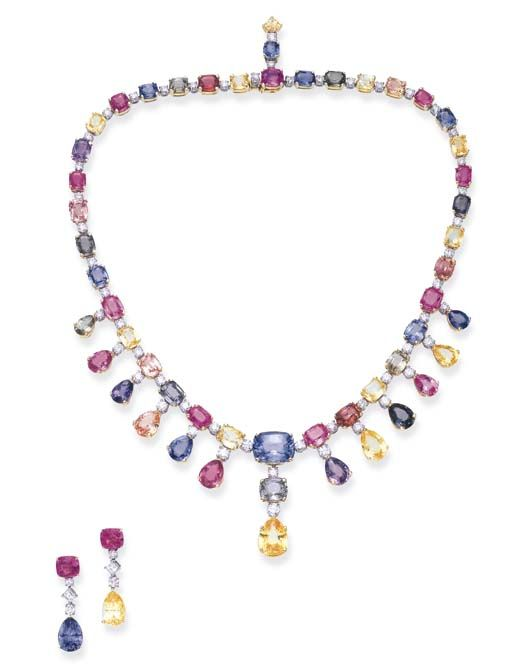 AN ATTRACTIVE SUITE OF MULTI-COLORED SAPPHIRE AND DIAMOND JEWELRY, BY BULGARI Comprising a necklace, composed of a graduated series of cushion-cut multi-colored sapphires, spaced by circular-cut diamonds, the front enhanced by a graduated pear-shaped multi-colored sapphire fringe, with circular-cut diamond accents; and a pair of ear pendants en suite, mounted in platinum and 18k gold, necklace 15 5/8 ins., ear pendants in a Bulgari black leather case