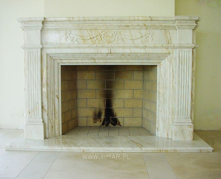 Portal kominkowy wykonany z marmuru. Stylizowany kominek rzeźbiony w kamieniu za pomocą maszyny numerycznej typu CNC. / www.i-mar.pl / Fire portal made of marble. Stylized fireplace carved in the stone with the numerical machine of the type CNC. / #kominek #kamieniarstwo #marmur #obudowakominka #biały #kamień #kremowy #photo #interior #masonry #fireplace #stone #cream #white #style #architecture #poland
